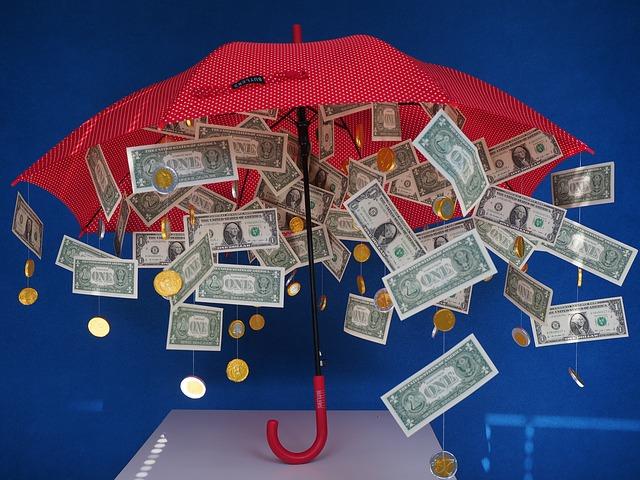 deštník a déšť z peněz